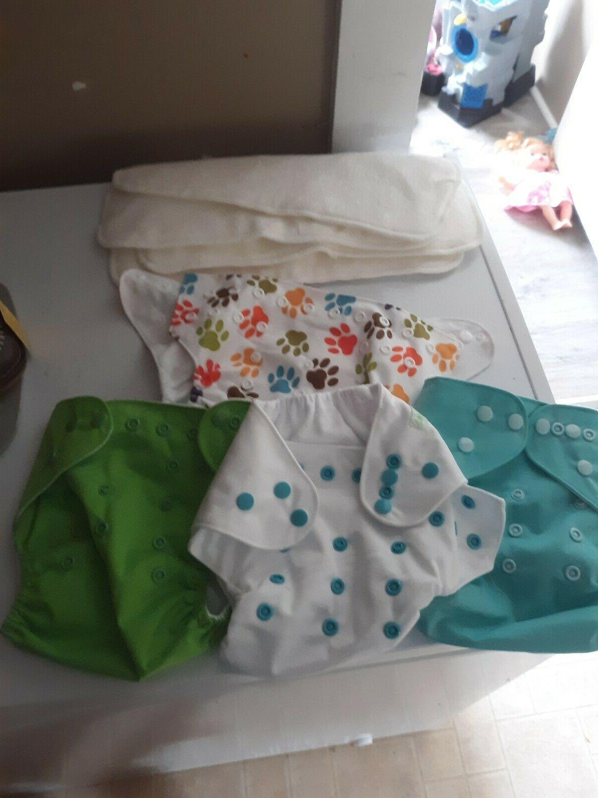 3 cloth diapers with inserts we have